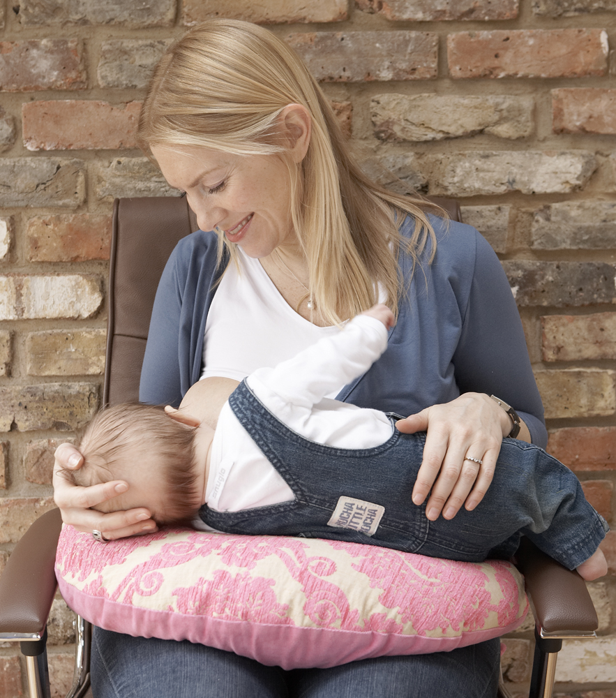 Baby nursing with pillow